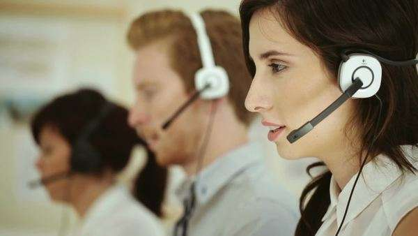 Customer support representatives taking calls from customers. Royalty-free stock video