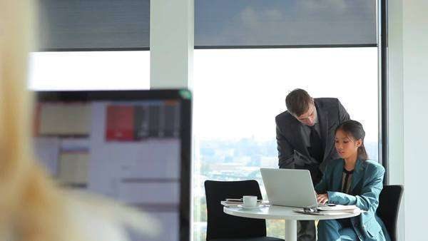 Businessman and businesswoman working together at the office. Royalty-free stock video