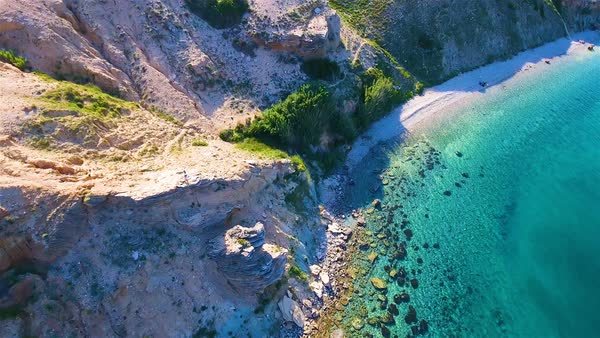 Aerial Shot Towards The Person On Cliff By Sea Pag Croatia Royalty