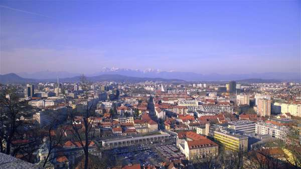 Panoramic view of city Ljubljana. Panning over city scape of main city in Slovenia. Sun going down with alps far in background. Royalty-free stock video