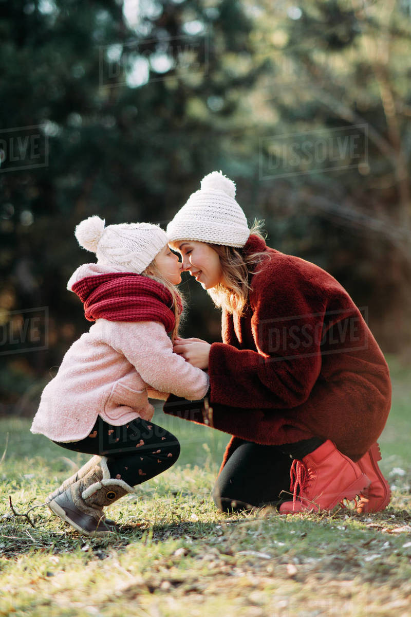 Mother and daughter play and have fun while walking in the forest. Royalty-free stock photo