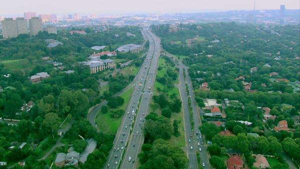 Aerial shot of the highway going into Johannesburg Rights-managed stock video