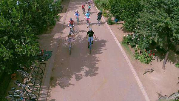 Aerial shot of cyclists riding through a street in Soweto Rights-managed stock video