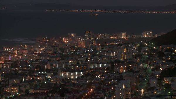 Time lapsed high angled extreme long shot of Cape Town city at night Rights-managed stock video