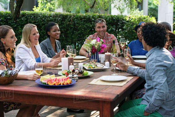 Friends gathered around party table Royalty-free stock photo
