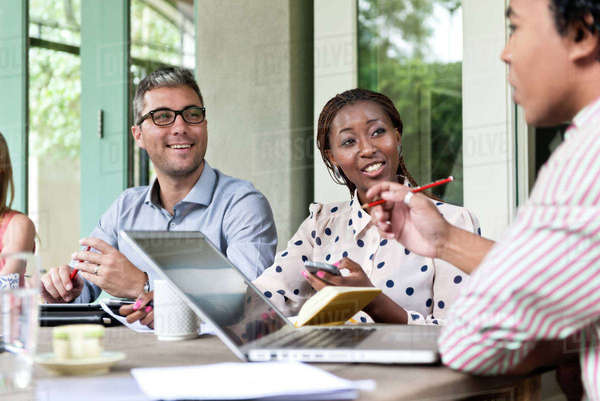 Two people listening to what another colleague has to say in a meeting Royalty-free stock photo