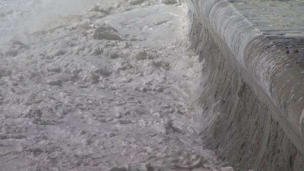 Close up of waves breaking on wall along board walk, Sea Point Rights-managed stock video