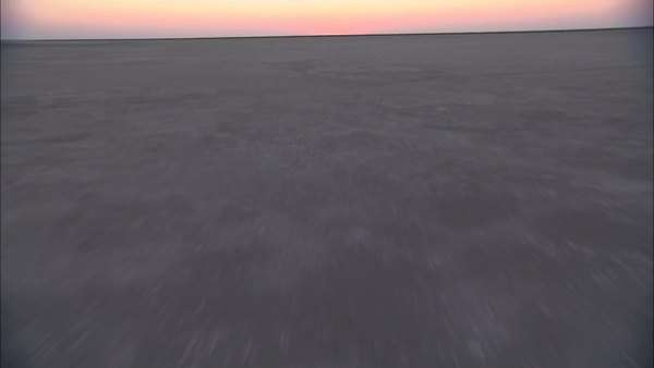 Aerial shot of three people walking on the Makgadikgadi Pan Rights-managed stock video