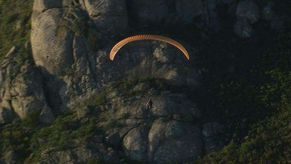 Aerial of tandem paragliders soaring over Cape Town Rights-managed stock video