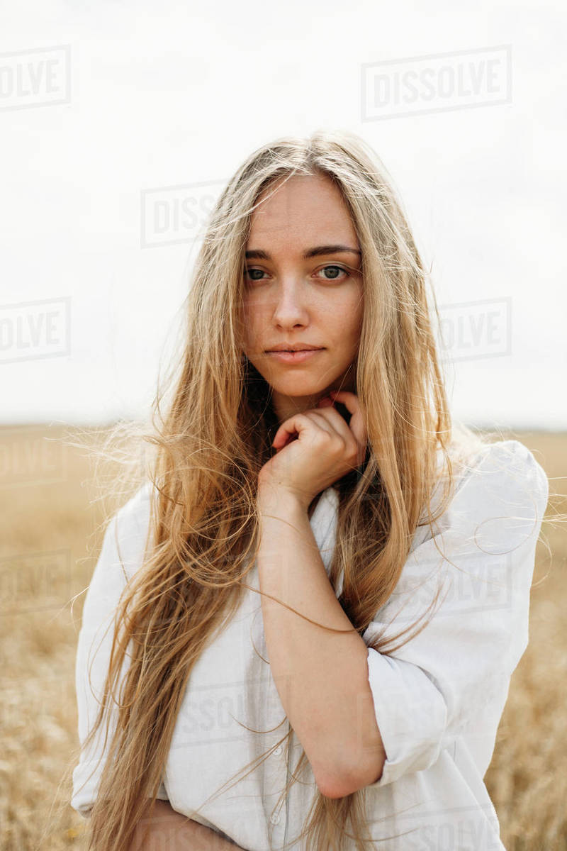 beautiful girl in a wheat field Royalty-free stock photo