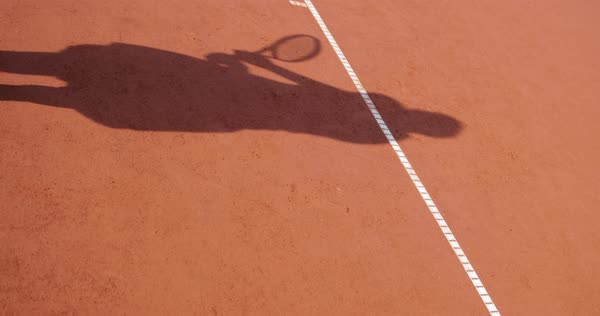 Slow motion shot of shadow of a woman playing tennis Royalty-free stock video