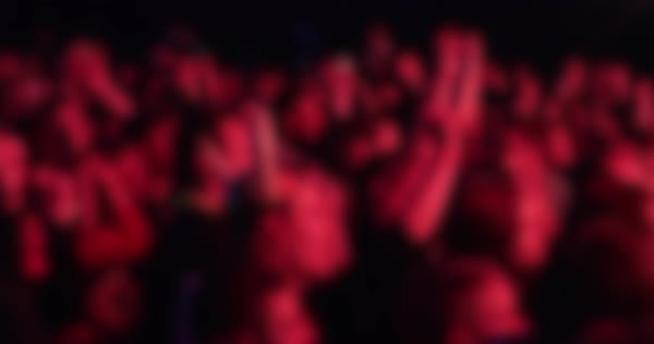 Out of focus shot of crowd waving arms at a concert Royalty-free stock video