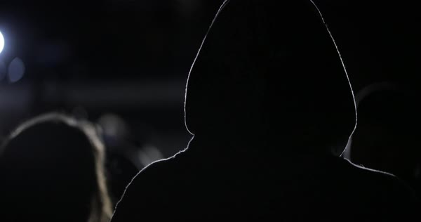Hand-held shot of a person in hoodie enjoying a concert Royalty-free stock video