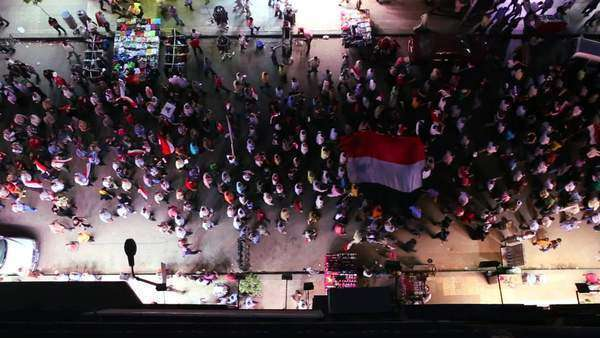 View from overhead looking straight down on protestors marching in the streets of Cairo, Egypt at night Royalty-free stock video