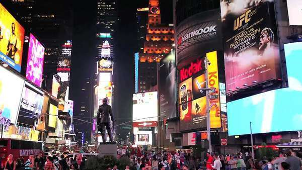 Times Square lit up and crowded at night Royalty-free stock video