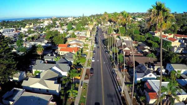 Rising aerial shot over a palm tree lined street in Southern California. Royalty-free stock video