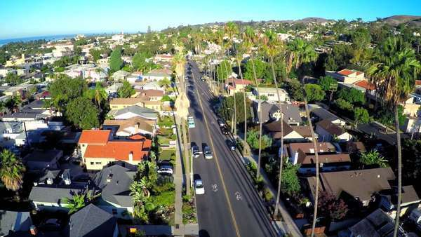 Beautiful aerial shot over a palm tree lined street in Southern California. Royalty-free stock video
