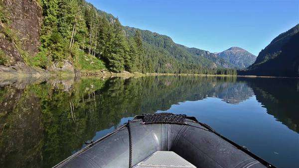 POV boat ride cruising through a glassy waters in Fords Terror in Tracy Arm-Fords Terror Wilderness Area, Southeast Alaska. Royalty-free stock video