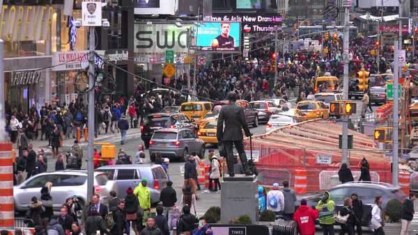 Crowds of cars and pedestrians in Times Square, New York City. Royalty-free stock video