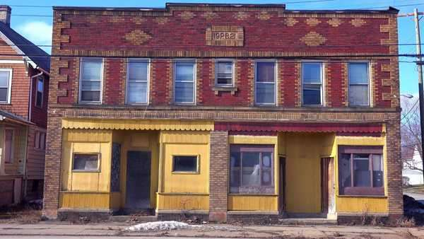 An old abandoned storefront suggests economic depression. Royalty-free stock video