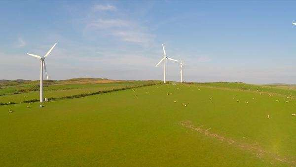 An aerial shot over a wind farm in Britain. Royalty-free stock video