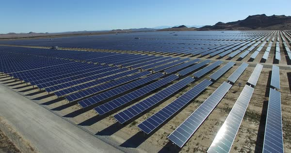 An aerial over a solar power farm in the Mojave Desert of California. Royalty-free stock video