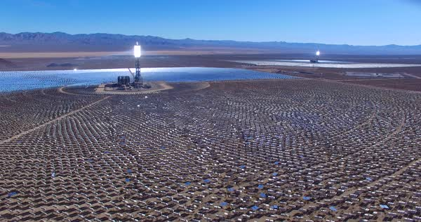 A beautiful aerial over a vast concentrated solar power farm in the Mojave Desert. Royalty-free stock video