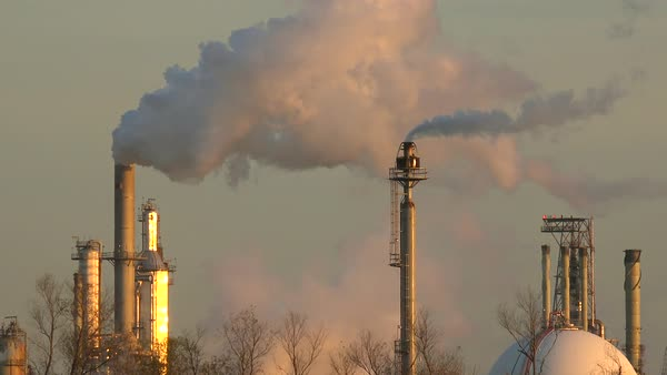 Smokestacks belch pollution into the sky. Royalty-free stock video