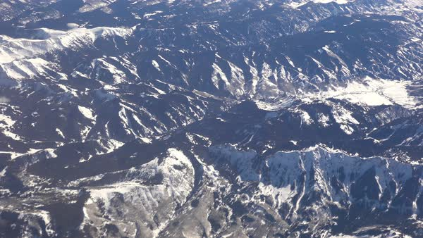 Aerial shot over the Rocky Mountains in snow in winter. Royalty-free stock video