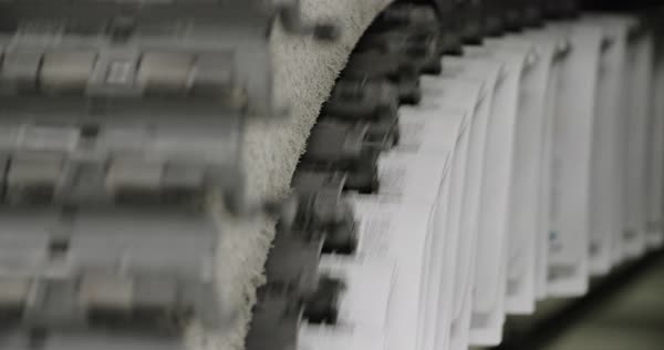 Newspapers move along a conveyor belt at a newspaper factory. Royalty-free stock video