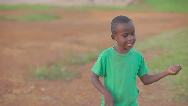 An African kid plays air guitar. Royalty-free stock video