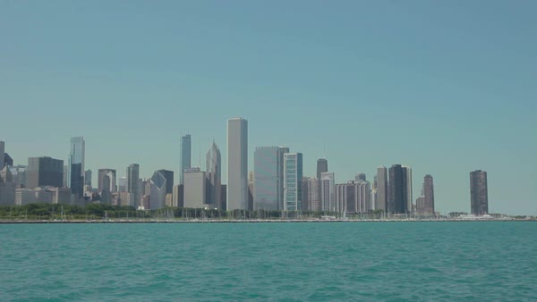 Reveal tracking shot of the skyline of Chicago, Illinois. Royalty-free stock video