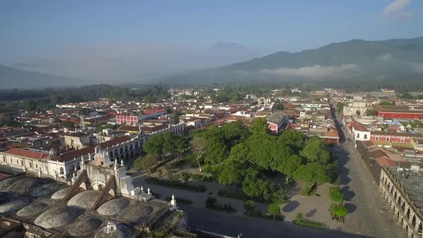 Beautiful aerial shot over the colonial Central American city of Antigua, Guatemala. Royalty-free stock video