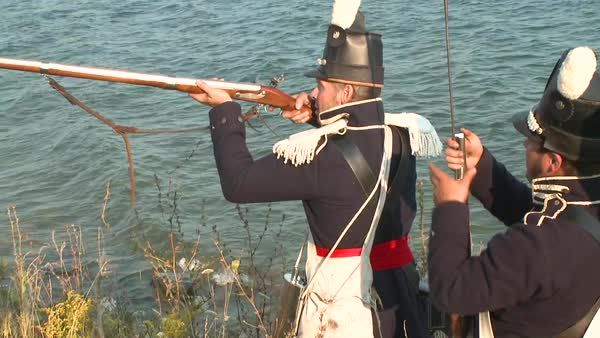 Men come out of the woods to fight a battle with arriving soldiers in this television style reenactment of the War of 1812. Royalty-free stock video