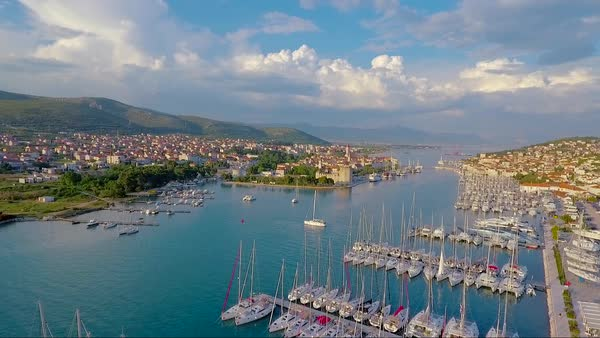 Aerial over a port and coastal fishing village in Croatia. Royalty-free stock video