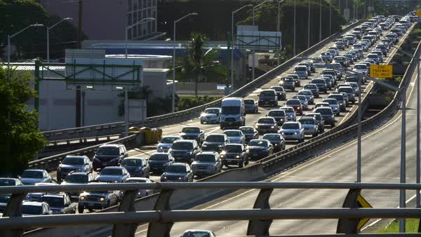 Daily morning westbound traffic lines up on the H-1 Freeway in Honolulu, Hawaii Royalty-free stock video