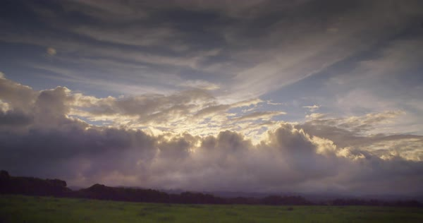 Time lapse of clouds moving over green fields on the island of Molokai, Hawaii. Royalty-free stock video