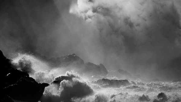 Large ocean waves roll into the coast of Hawaii and break on the shore. Royalty-free stock video