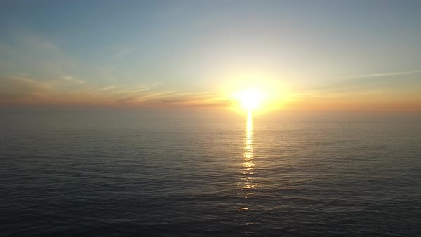 A beautiful aerial above a golden sunset over the California coastline north of San Diego. Royalty-free stock video