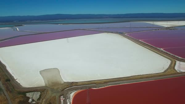 Aerial footage over the remarkable red and white salt flats in the Fremont, California bay area. Royalty-free stock video