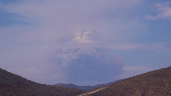 A timelapse shot of smoke rising in a huge mushroom cloud as a wildfire rages. Royalty-free stock video