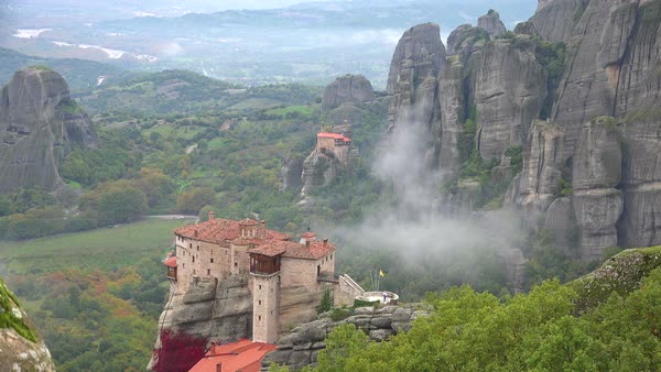Fog rises in the morning around the beautiful monasteries of Meteora, Greece. Royalty-free stock video