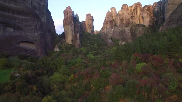 Beautiful rising aerial over the rock formations of Meteora, Greece. Royalty-free stock video