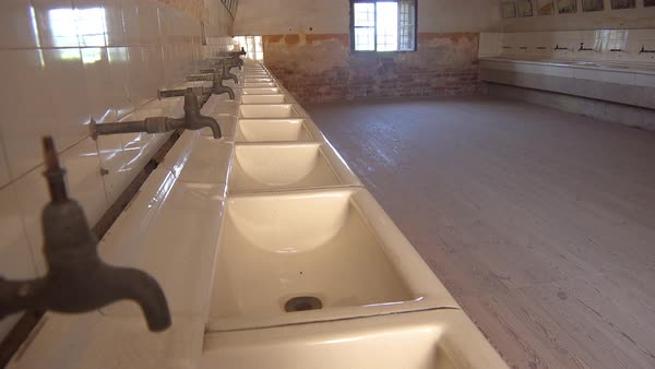 Interior of bathrooms at the Terezin Nazi concentration camp in Czech Republic. Royalty-free stock video