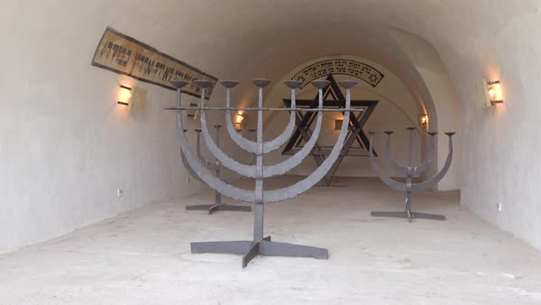 A Jewish menorah near in the crematorium at the Terezin Nazi concentration camp in Czech Republic. Royalty-free stock video