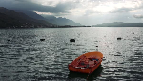 A beautiful orange rowboat on the shores of Boka Bay, Montenegro. Royalty-free stock video