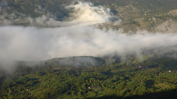 Time lapse of clouds and fog moving through a canyon in Montenegro. Royalty-free stock video