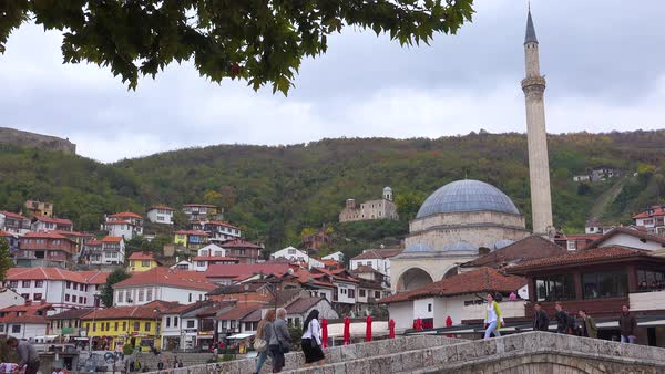 Establishing shot of a town in Kosovo with bridge and mosque. Royalty-free stock video