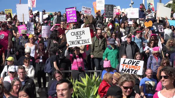 Hundreds of thousands march, chant and carry signs to protest the presidency of Donald Trump in downtown Los Angeles, California. Royalty-free stock video