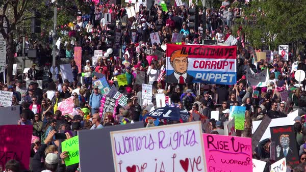 A huge protest against the presidency of Donald Trump in downtown Los Angeles identifies the President as a corrupt illegitimate puppet. Royalty-free stock video